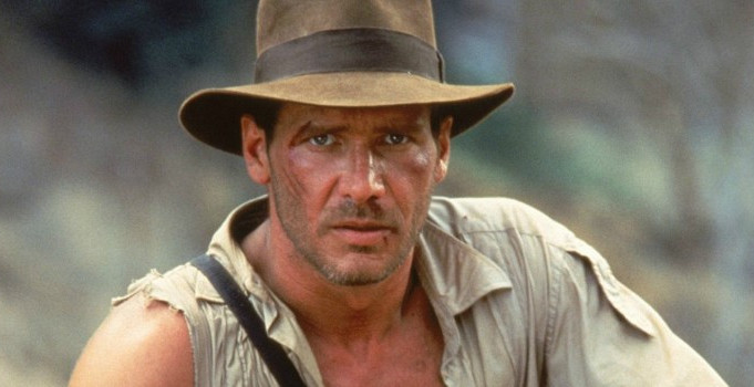 Harrison Ford as Indiana Jones looks directly at the viewer.